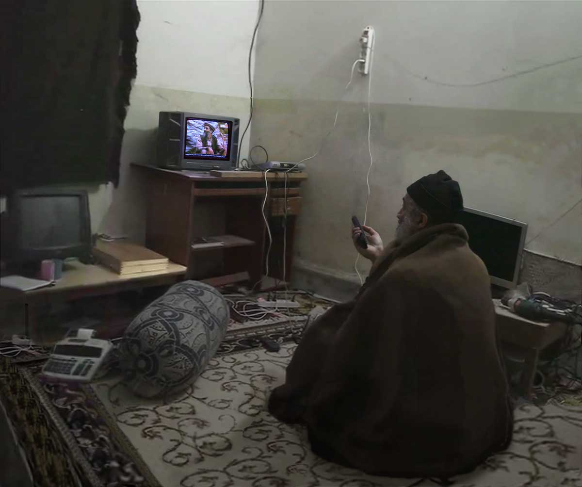 Osama bin Laden watching himself on TV